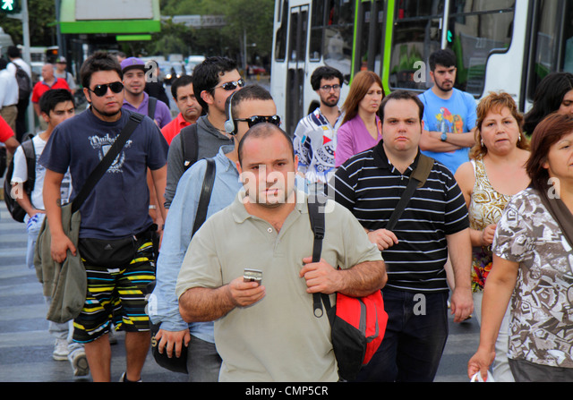 Santiago Chile Providencia Avenida Vicuna Mackenna street scene marked crossing crowded Hispanic man woman walking - Stock Image