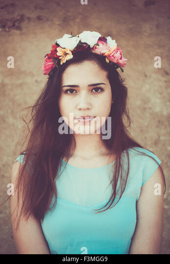 Beautiful young woman wearing a flower crown - Stock Image