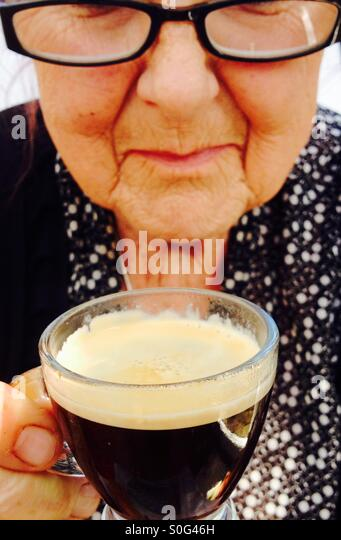 Woman drinking espresso coffee - Stock Image
