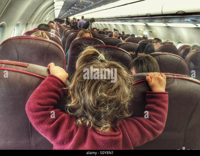 Baby on a plane - Stock Image