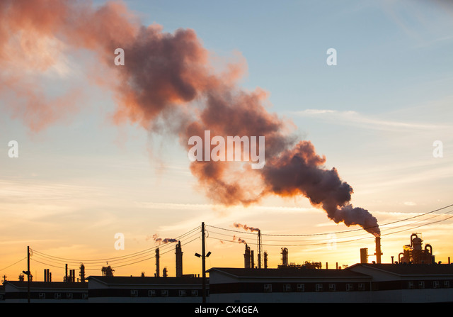 The tar sands upgrader plant at the Syncrude mine north of Fort McMurray, Alberta, Canada, at sunset. - Stock Image