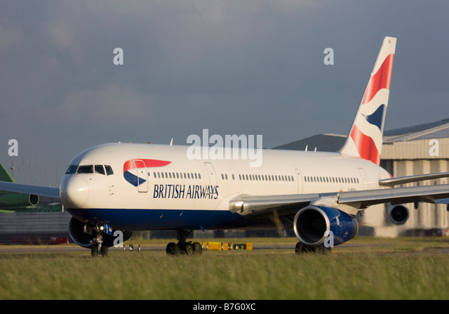 British Airways Boeing 767-336/ER taxiing for departure at London Heathrow airport. - Stock Image