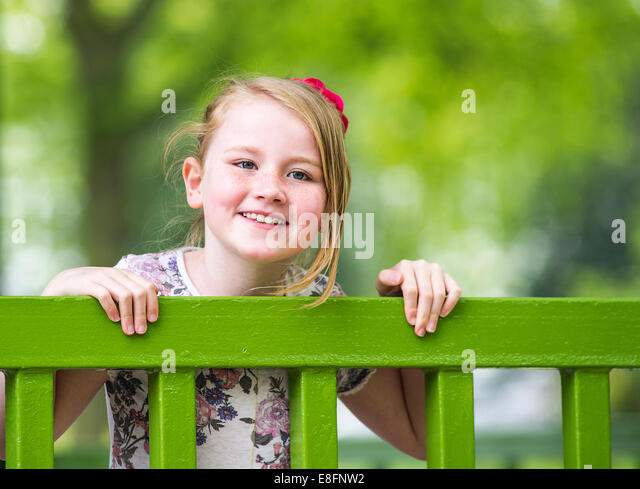 UK, Warwickshire, Rugby, Portrait of happy girl (8-9) - Stock Image