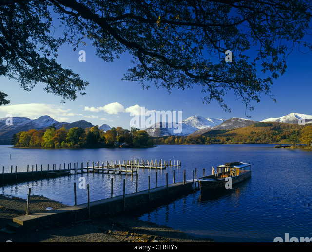 Boat tied to a jetty on Derwent Water at Friar's Crag. - Stock Image