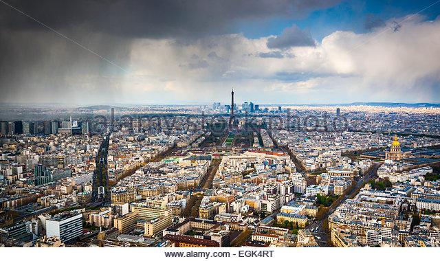Eiffel Tower below cloudscape - Stock Image