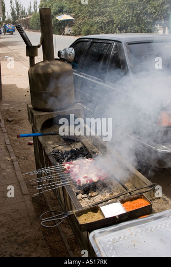 Kebabs cooking over hot coals - Stock Image
