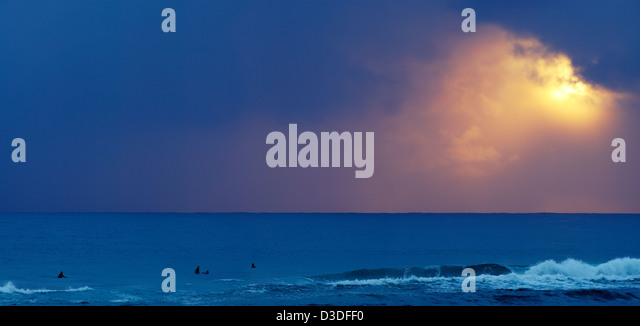 Surfers at sunrise Burleigh Heads - Stock Image