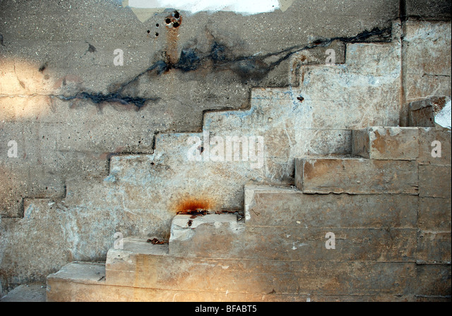 Concrete stairs on concrete wall - Stock Image
