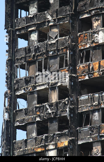 London, UK. 16th June, 2017. Burned out cladding seen on the charred remains of the 24-storey block Grenfell tower - Stock Image