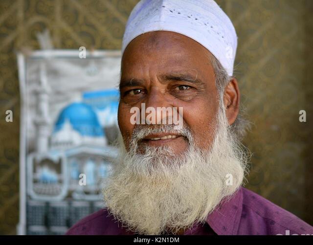 Imam of the small Muslim community at Rayagada/Odisha, India, with Muslim beard and prayer bump on his forehead, - Stock Image
