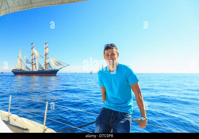 Young man sailing, San Diego, California, USA - Stock Image