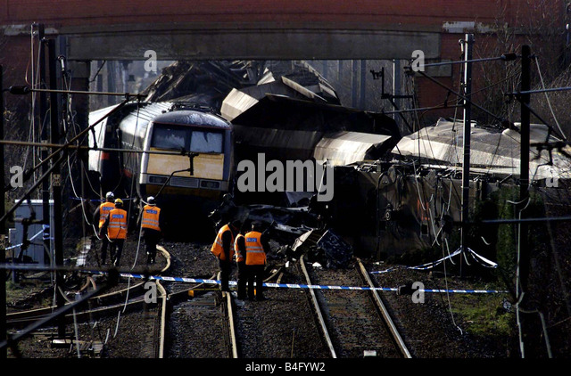 Accident investigators look through the wreckage of the GNER Express which was derailed by a car that fell off the - Stock Image
