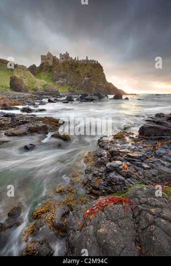 Dunluce Castle captured in evening Light - Stock-Bilder