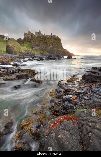 Dunluce Castle captured in evening Light - Stock Image