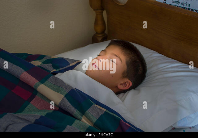 9 - 10 year old Korean/Caucasian boy sleeping. MR  © Myrleen Pearson - Stock-Bilder