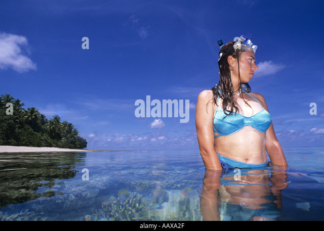 Girl snorkeller in the Western Pacific by tropical Atoll - Stock Image