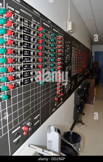 Control panel with electric switches in an American medium security prison. The officer can open and lock doors - Stock Image
