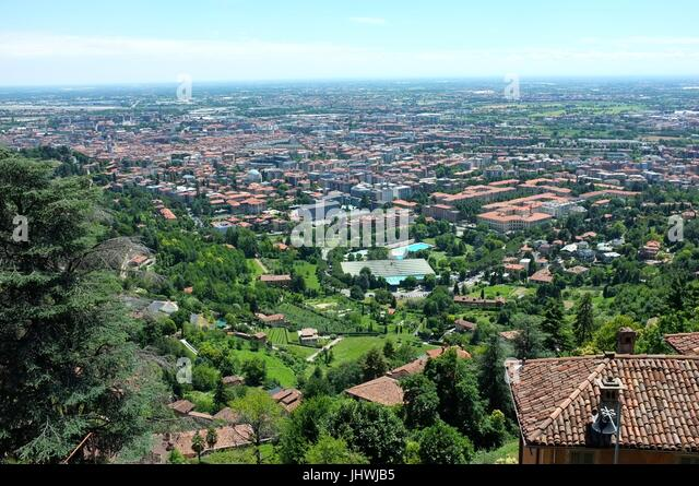 The skyline of the lower city facing south from Saint Vigilio, Citta Alta (upper city), Bergamo, Lombardy, northern - Stock Image