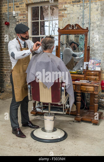 Traditional 1940s Barber re-enactor re-enactment - Stock Image