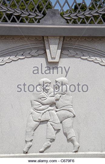 Japan Tokyo Harajuku bridge detail sumo wrestlers art - Stock Image