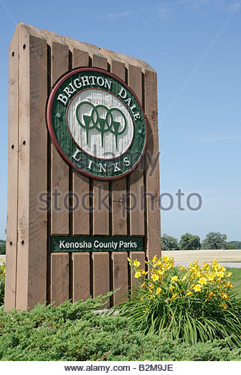 Wisconsin Kenosha Kansasville Brighton Dale Links golf course county park system entrance wood sign logo flowers - Stock Image