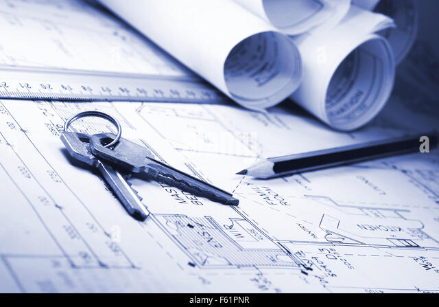 rolls of house plans with key and pencil - Stock Image
