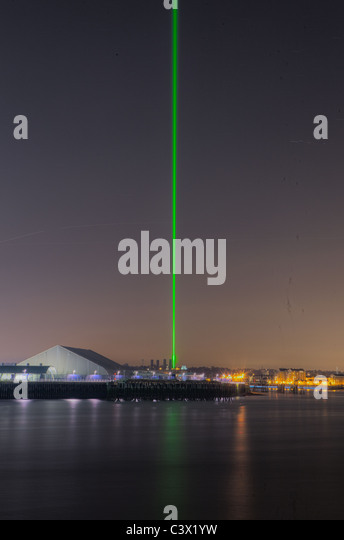 View of Greenwich Observatory laser beam taken from the Isle of Dogs London - Stock Image