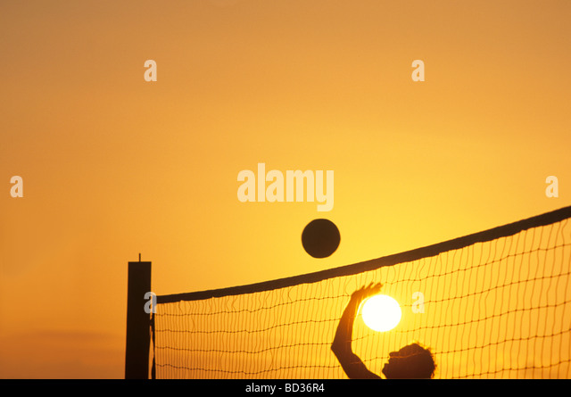 Volleyball Player and Sun - Stock Image