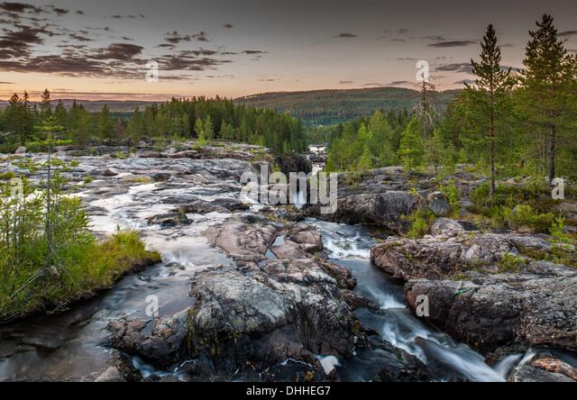 River flowing through gorge, Storforsen, Lapland, Sweden - Stock Image