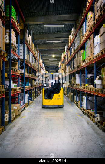 storage room with industrial truck - Stock Image