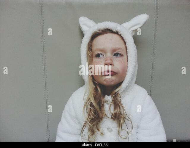 Girl (4-5) in bunny rabbit outfit - Stock Image