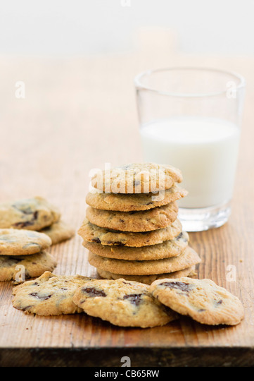 Soft sultana cookies with a glass of cold milk - Stock Image