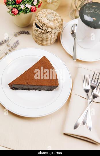Slice of chocolate cake on plate - Stock Image
