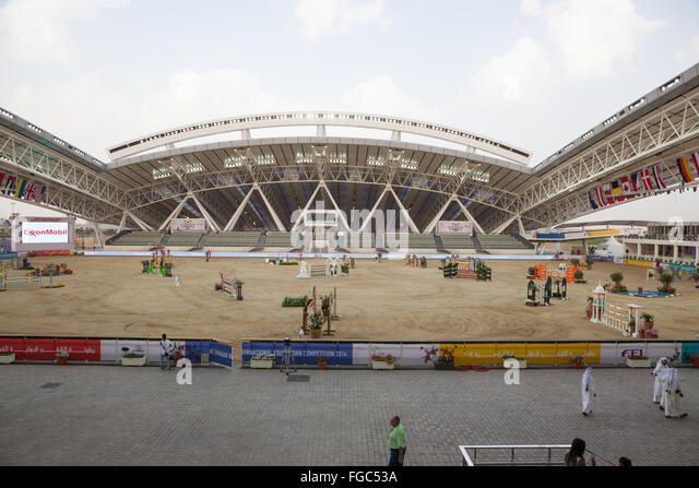 Preparations for show jumping in outdoor arena at CHI Al Shaqab 2014 - Stock Image