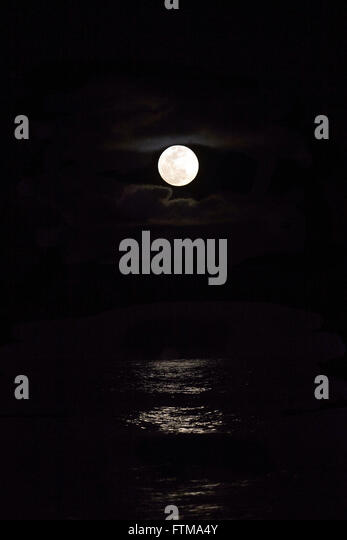 Full moon rising in the sea - Peninsula of Marau - Stock Image