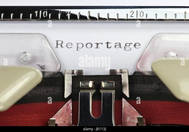 Reportage (German word for report) written with old typewriter - Stock Image
