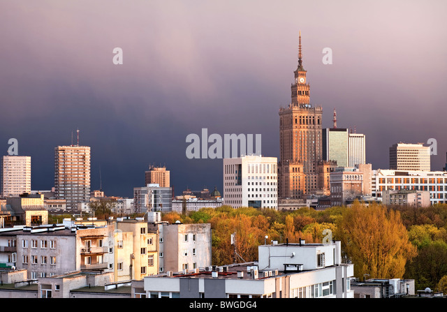 Warsaw, capital city of Poland, featuring Palace of Culture and Science, Srodmiescie district. Sunset time, stormy - Stock-Bilder