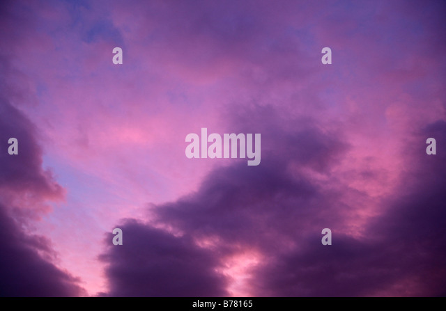 purple sky and clouds backdrop background - Stock Image