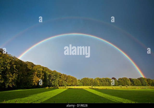 The Netherlands, 's-Graveland. Rural estate called Hilverbeek. Double rainbow. - Stock Image