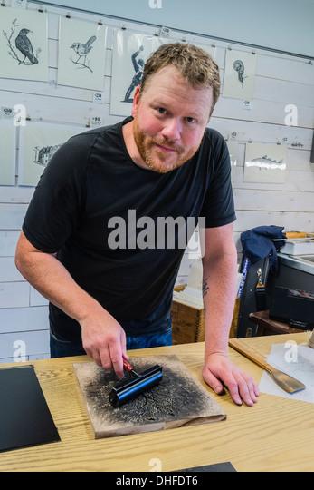 Artist Graham Blair, a woodblock printmaker at his studio in Quidi Vidi in St. John's Newfoundland. - Stock Image