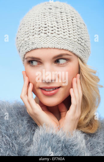 Beautiful woman in knitted hat - Stock Image