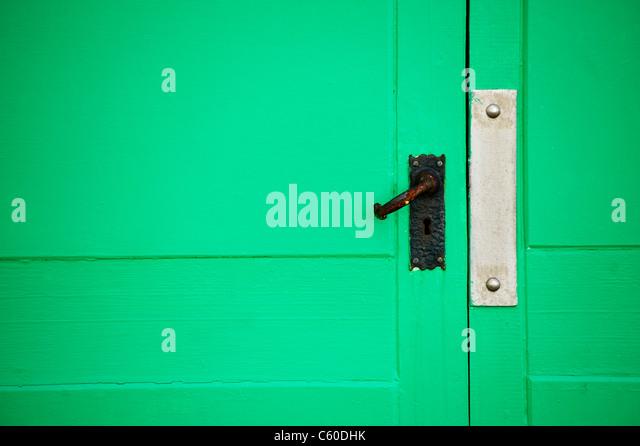 Bright green beach hut door close up - Stock Image