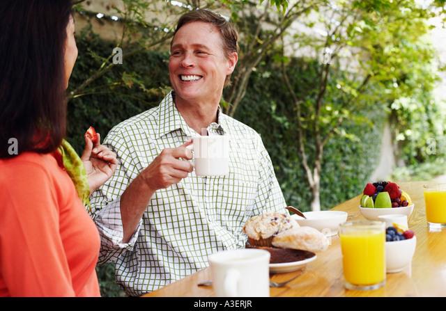 Mature couple having breakfast - Stock-Bilder