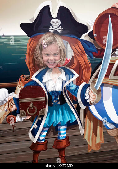 young girl having fun at seaside amusement - Stock Image