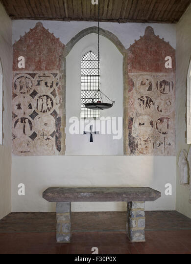 Brook, St Mary, Kent. 13th century wall paintings in the chancel - Stock-Bilder