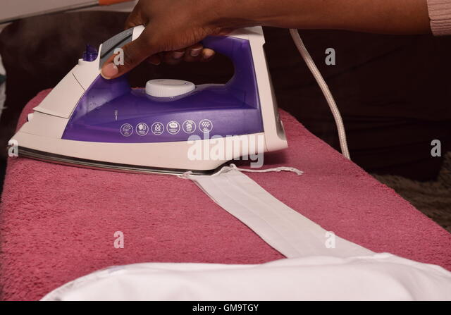 African Woman Ironing - Stock Image