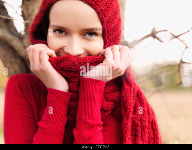 A woman looking playfully at the camera - Stock Image