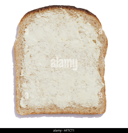A buttered slice of wholemeal bread - Stock Image