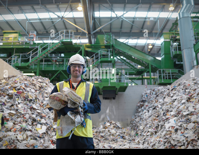 Worker With Paper Being Recycled - Stock Image