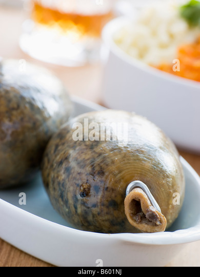 Whole Haggis with Neeps Tatties and Whiskey - Stock Image